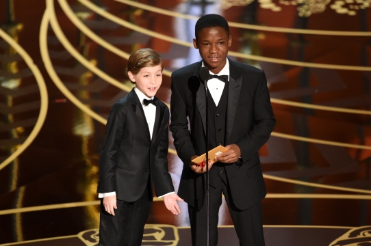 HOLLYWOOD, CA - FEBRUARY 28: Actors Jacob Tremblay (L) and Abraham Attah speak onstage during the 88th Annual Academy Awards at the Dolby Theatre on February 28, 2016 in Hollywood, California. (Photo by Kevin Winter/Getty Images)